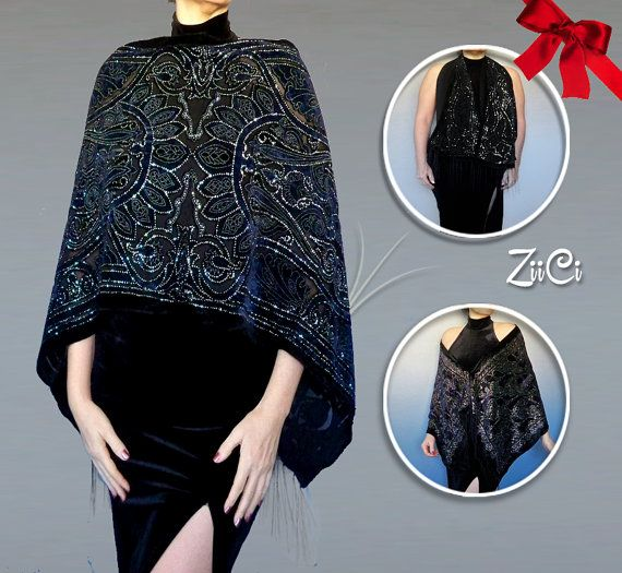 Deck the shawls in this glittery chiffon and velvet shawl available in blue, purple or black. It has a unique adjustable neckline that allows you to keep