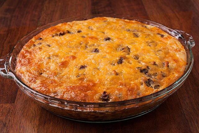 An easy cheeseburger pie recipe. You'll need onion, ground beef, cheddar cheese, and a batter made from flour, baking powder, eggs, and milk.