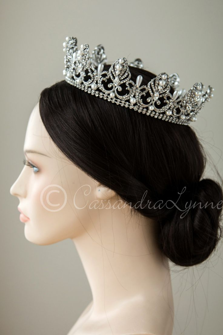 Antiqued silver not available until May! Make a glamorous statement with this royal, full circle bridal crown. Ivory teardrop pearls alternate with regal rhinestone covered designs set in antique silv