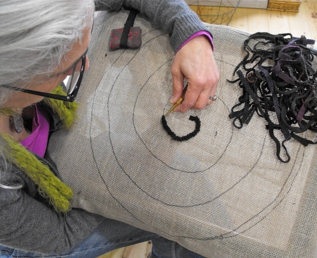 Hook a spiral chair pad with Karen Kahle. BEST RUG HOOKING TEACHER EVER!  If you ever have a chance to take a class with Karen DO IT!  She will inspire you to see color in a whole new light.