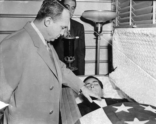 Mickey Cohen views the body of Johnny Stompanato at the funeral home 1958