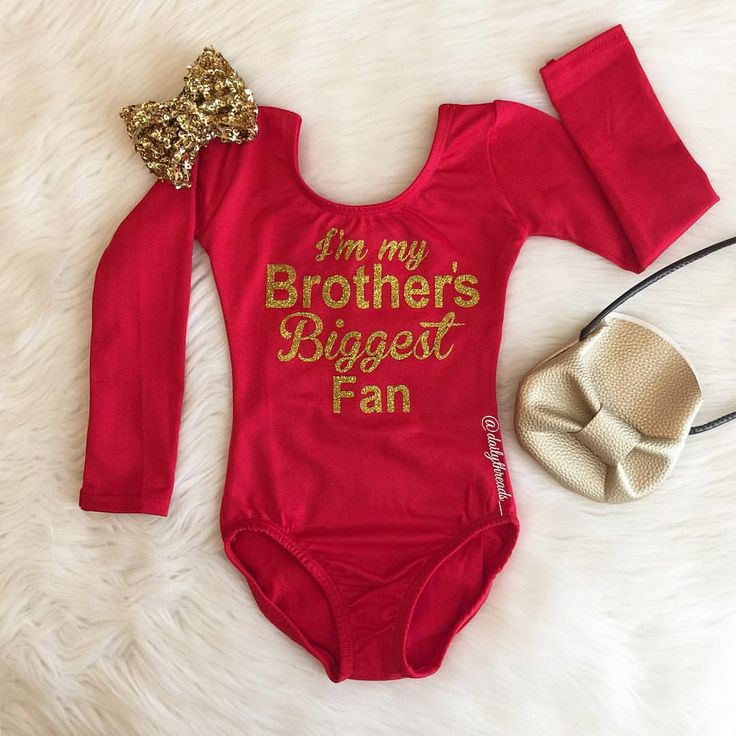 """Instagram @dailythreads_ Featuring our """"I'm my Brother's Biggest Fan"""" Red Long sleeve Leotard with Gold glitter design!✨ Please indicate """"Gold Glitter"""" at check out. Standard is Black glitter. #ImMyBrothersBiggestFan #Fan #cheer #biggestfan #bigfan #cheerleader #game #baseball #basketball #soccer #football #squadgoals #leotard #dance #dancer"""