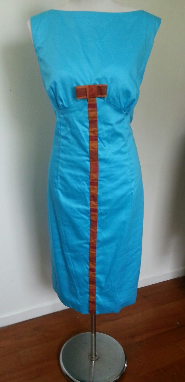 1960's inspired party dress. Cotton drill with bright contrasting bow detail. By Gaylene Allam.