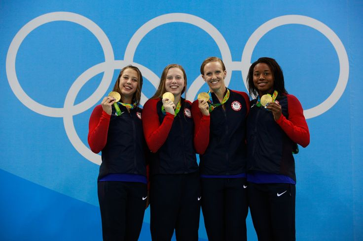Gold medalists Kathleen Baker, Lilly King, Dana Vollmer, Simone Manuel of the United States celebrate on the podium during the medal ceremony for the Women's 4 x 100m Medley Relay Final on Day 8 of the Rio 2016 Olympic Games at the Olympic Aquatics Stadium on August 13, 2016 in Rio de Janeiro, Brazil.