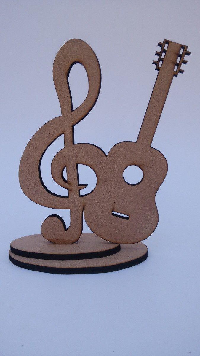 Clave de sol com violão em MDF 6mm com base de sustentação.  Dimensões: 20 cm de altura x 15 cm de largura x 6mm de espessura.