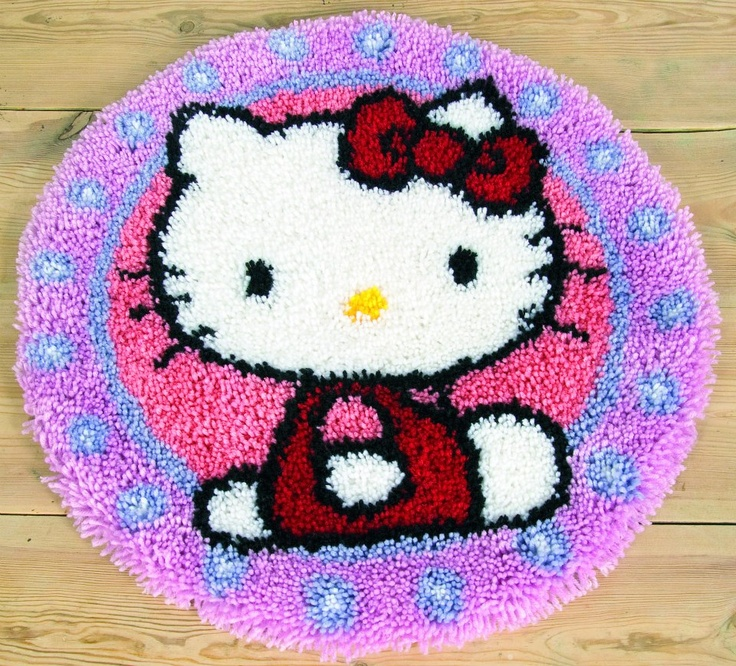 Latch Hook Rug Kit: Hello Kitty    Hand painted large hole mono canvas: 52% cotton, 48% polyester. 18 holes / 10cm. 4.5 stitches/inch. Yarn: 100% acrylic. (Cut packs). Includes binding tape. Finished size approx 55cm / 22in.