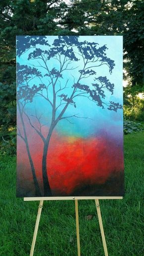Tree silhouette against red sunset and blue sky. Easy-Acrylic-Canvas-Painting-Ideas-for-Beginners