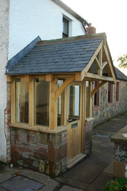 Enclosed oak porch with overhang