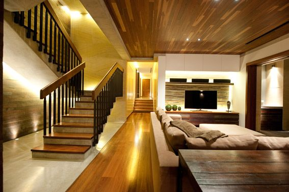 Grey Ironbark Timber featured throughout flooring, ceiling and wall paneling and stairs.
