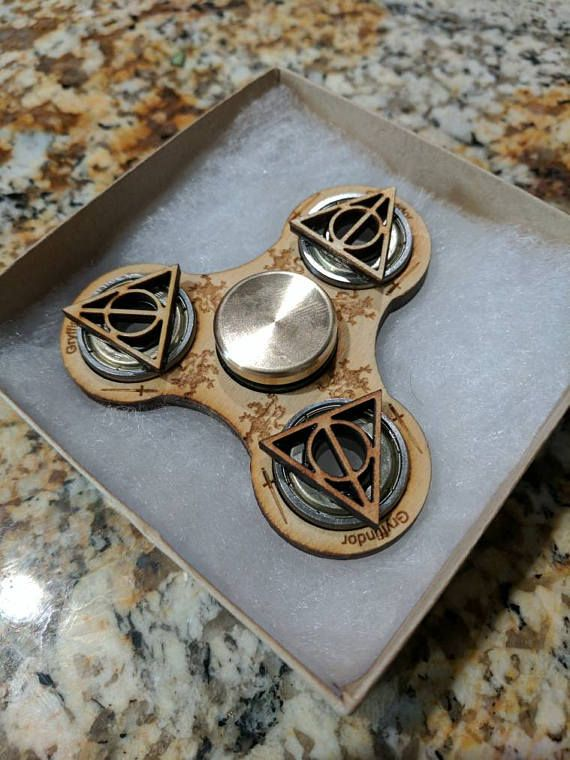 There's finally a fidget spinner that I want! Gryffindor Harry Potter Themed Spinner :O