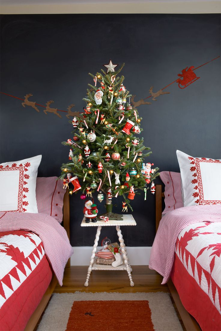 Perfect for a kids' room, this retro Christmas tree is as jolly as Kris Kringle himself, thanks to a vintage tree stand and old-school ornaments.