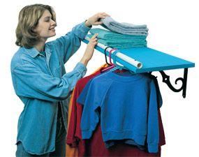Turn a shelf into a clothes hanger rack Laundry shelf does double