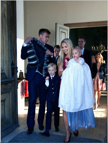 Nicklas Bendtner and his ex, Caroline Fleming, put on their happy faces at the baptism of their son, Nicholas Christian Juel Bendtner, in Denmark