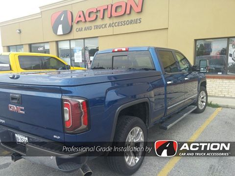 LSII Fiberglass Tonneau Cover by A.R.E. Truck Caps and Tonneau Covers Installed on this new GMC Sierra