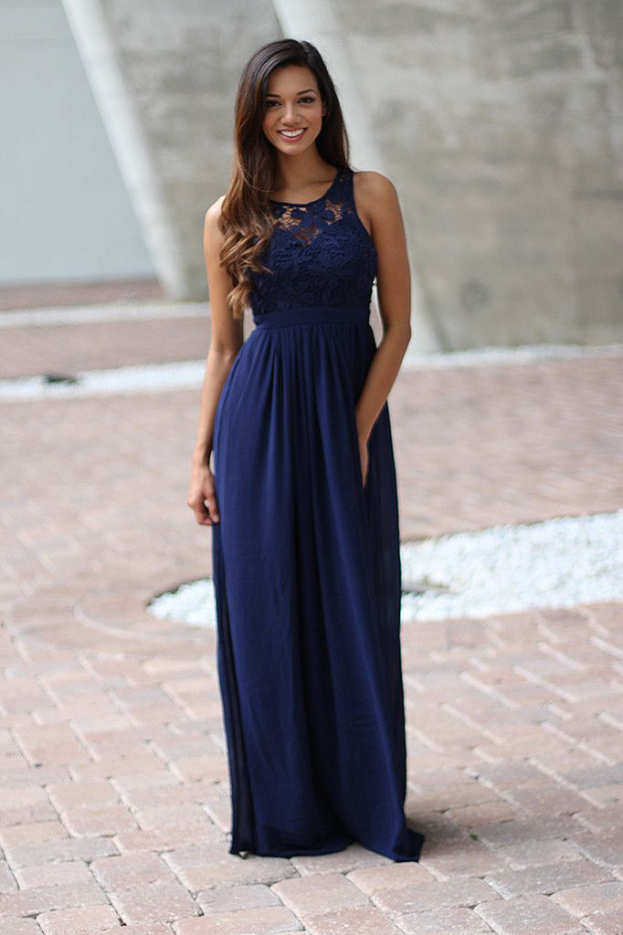 Bridesmaids Alert!!! This super elegant Navy Crochet Maxi Dress with Open Back is BACK! Perfect for any special occasion! We love its beautiful flowy skirt and open back! Check out other maxi dresses