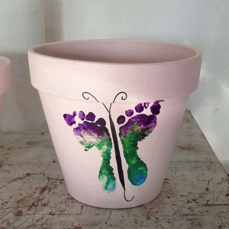 What a wonderful Mothers Day idea. Use terra cotta pots, spray paint them white and use acrylics for the design. Love the butterfly idea made from baby foot imprints. Add a gerbera daisy, peace lily or reiger begonia into the pot for a most amazing gift.