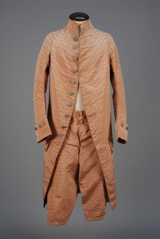 Coat and breeches, 1770-1785. Pink silk with allover brown vertical dashes, fall-front breeches with corner button pockets and kneed band.