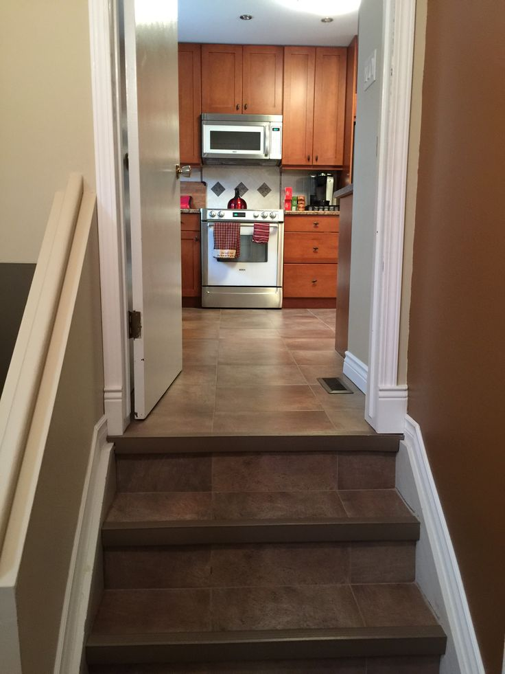 LVT is a great entry way option...durable and you don't have to seal the grout!