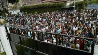 Image copyright                  Reuters             Image caption                                      Protesters gathered outside the home of the late opposition leader Etienne Tshisekedi                               Police have fired tear gas and bullets to disperse...