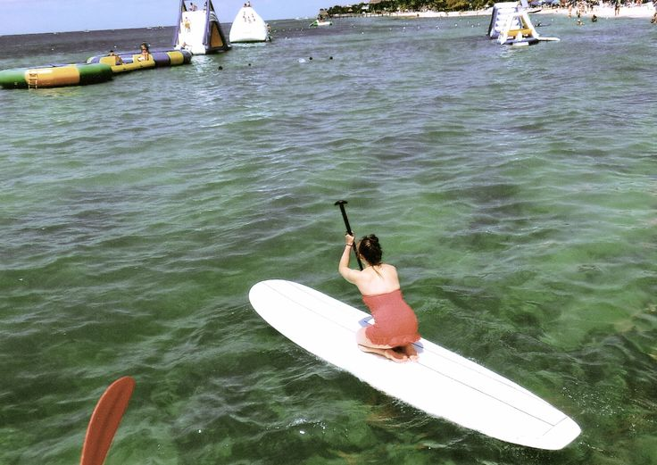 paddle boarding.  Paddle boarding is insanely fun! This was my first time out on the ocean in Mexico and it was beautiful!  After lifeguarding at a camp this summer, I have learned how to stand on a paddle board and I traveled all over the lake.