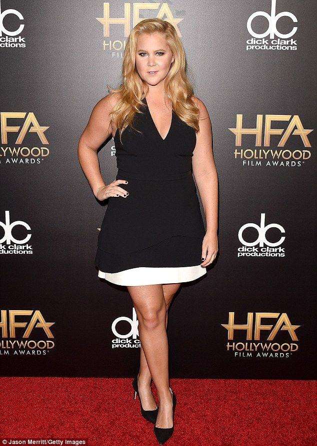 Blonde ambition: Comedian Amy Schumer opted for a basic halter LBD, featuring a white hemline, which was picked by stylist Leesa Evans
