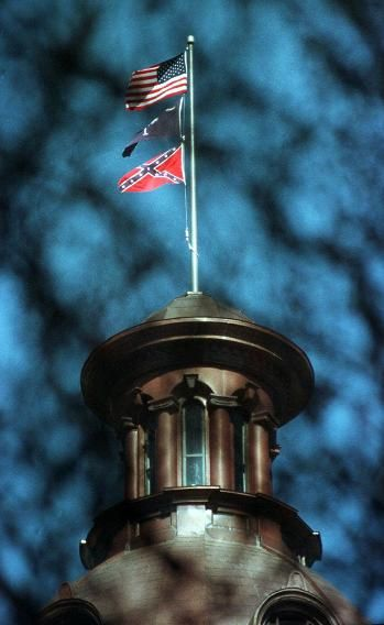 Flags Fly Atop The Dome Of The South Carolina Statehouse