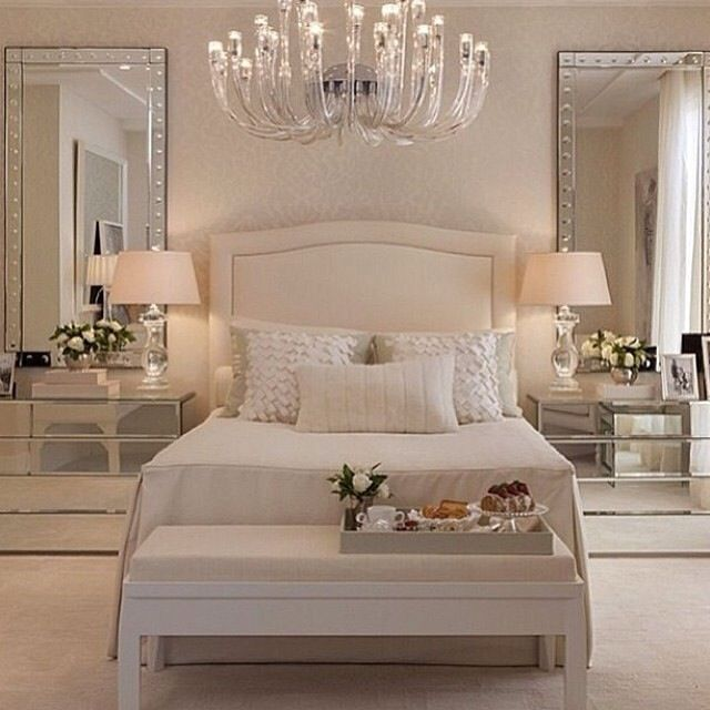 love the idea of a chandelier in a master bedroom. Big transformation with one fixture.: