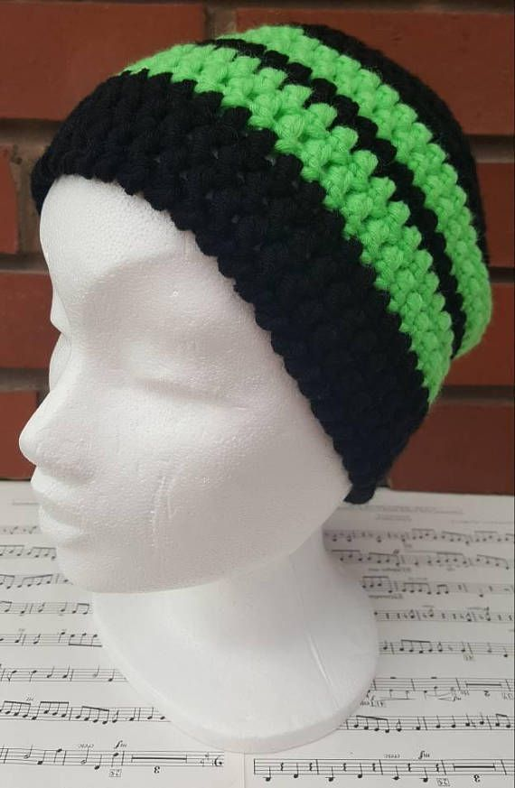This is a hand crochet hat made in snuggly yarn. An adult hat, suitable for a large head and very comfortable if you have a lot of hair like me! A black hat with vibrant neon green stripes. A perfect gift for anyone in your life, or why not treat yourself. The simple crochet beanie design means it this winter hat is suitable for a woman or man. Made from lighter double knitting yarn means you can keep warm and is perfect for the spring time. Made from black and neon green yarn composed of…