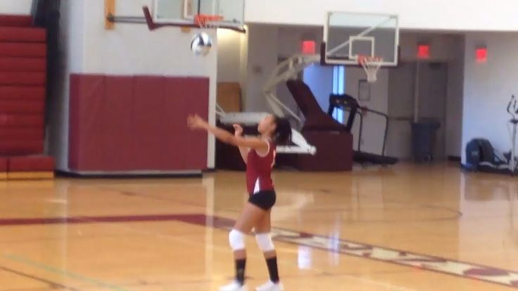 Kayci Johnson, serving a volleyball during a JV game as a freshman!