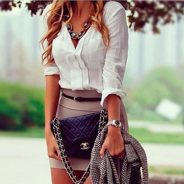 White button up tucked into a camel(ish) colored skirt. Add a statement necklace, arm candy, a cute bag