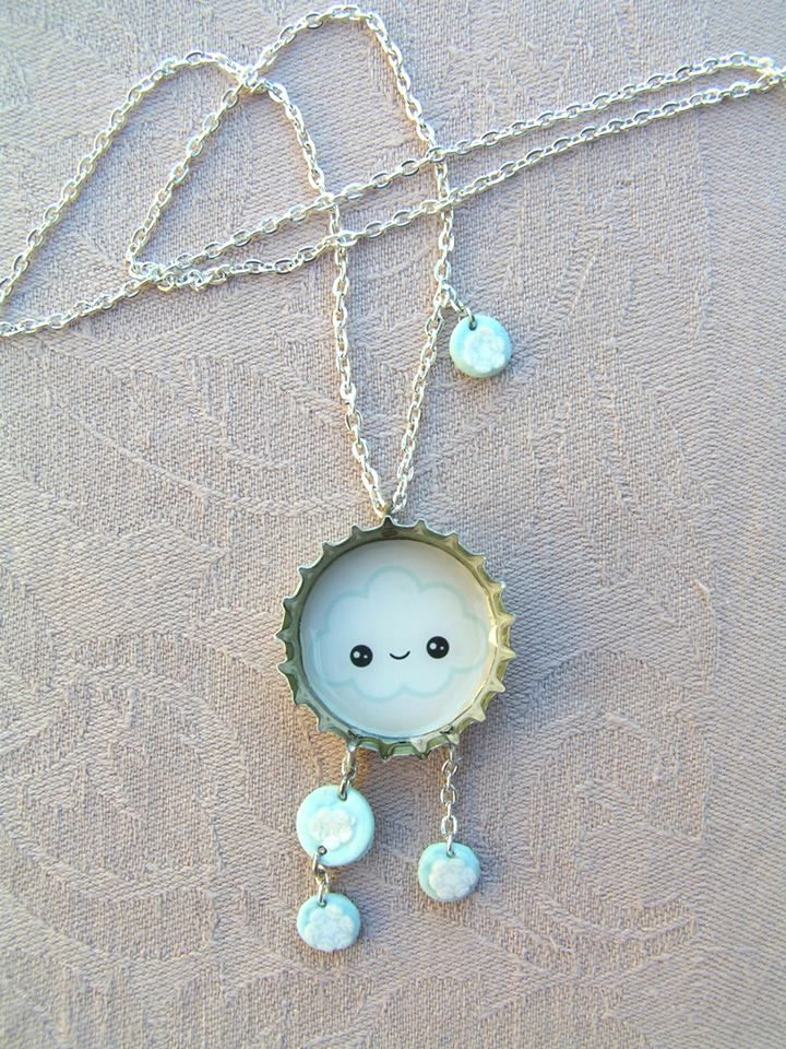 Snow Cloud   --    Cute and cheerful snow bearing cloud necklace in silver-colored cap, with small polymer clay snowflakes.