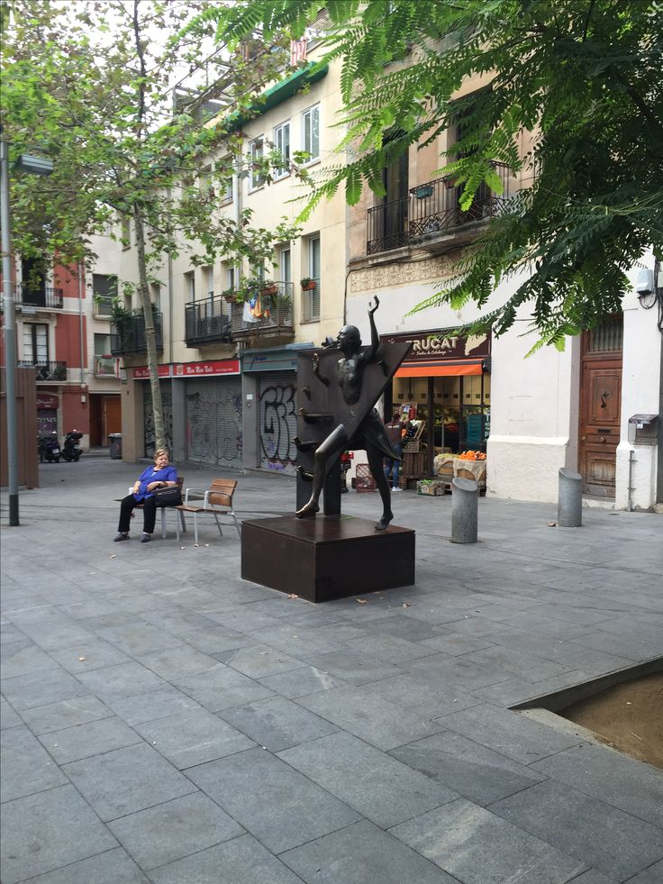 This picture was taken in the Gràcia neighborhood in Barcelona, in Plaça del Diamant. This statue is made from a scene  the novel La plaça del Diamant, and the woman is its heroine, La Colometa who grew up in the square during the Spanish Civil War. This statue combines history with fantasy.