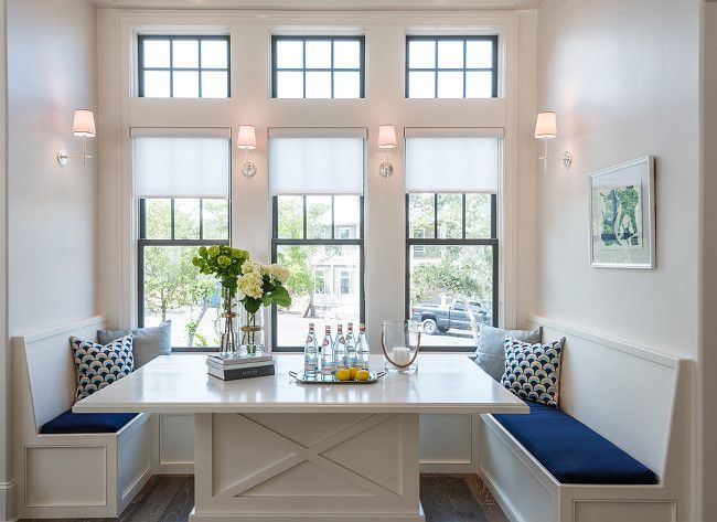 Breakfast Nook Filled With Built In Benches Lined With Cobalt Blue Cushions  Facing Each Other Across From A Built In Dining Table Placed Under Windows  ...