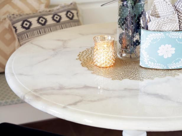 HGTV.com shows how to transform a plain wooden table into a gorgeous, expensive-looking marble accent piece.