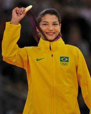 Brazil's Sarah Meneses, 2012 Olympian gold winner for women's judo, trained on her sport unknown to her parents, and did it while completing her bachelor's degree and learning English as a language.