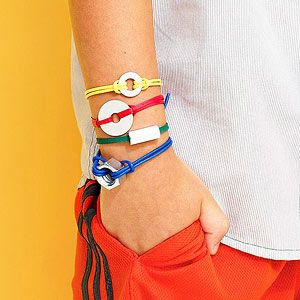 Your child can help peruse the hardware store to choose the washers, nuts, and other small metal pieces needed to make these tough bracelets. Use simple hitch knots to attach two lengths of leather cord to the hardware. Tie the ends together around the wrist.