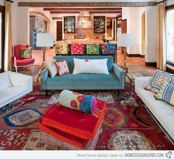 Image: Ashley Astleford Interiors  This room sure is pretty chic. Unique pieces of furniture paired with colorful and printed pillows. The rug even seems Mediterranean or something Moroccan!