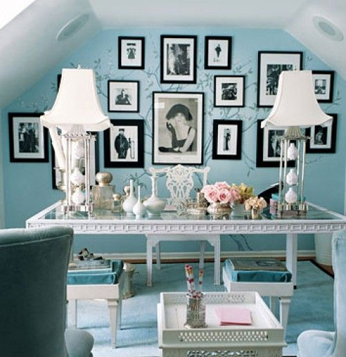 Glam light blue, white, and black home office. Painted tree mural under the frames. As seen in domino magazine.