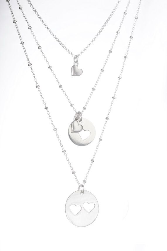 Mother Daughter and Grandma Gift. Grandmother Jewelry  <<< A set of 3 necklaces for the love between Grandmothers, Daughters & Granddaughters >>>  - - - {{ ITEM DETAILS }} - - -  The 18mm pendant, with two hearts on an 18 sterling silver beaded chain  The second necklace has a 12mm pendant with a heart cut out, plus a heart charm, delicate sterling heart on an 18 chain.  The granddaughter necklace is a sterling heart charm on a 16 necklace  The necklace is presented on a GRANDMOTHER…