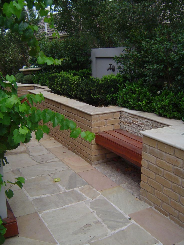 French country courtyard with built in bench seating