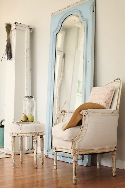 Love the look of a large mirror against a wall.