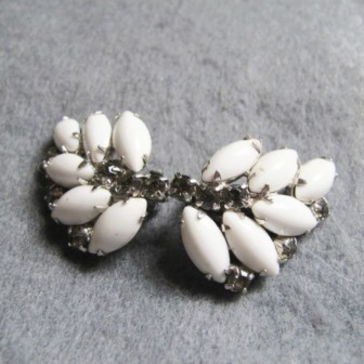Vintage 1950\'s Milk Bead Navette earrings on Velvet Rose's Pin Up Dressing Room  6 Stunning Vintage 1950's milk bead navette earrings. Three navettes on each side slightly off set with a centre row of a silver tone crystal as well as a crystal set between each navette on the outside leaves. Unique
