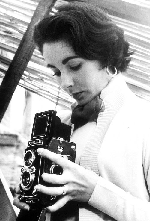 Elizabeth Taylor with a Rolleiflex camera, 1950s.