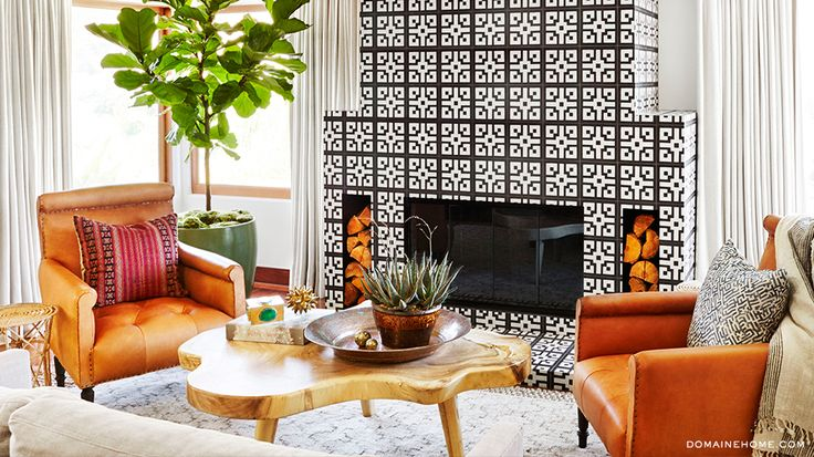 Before & After: Jessica Alba's Brilliant Bedroom Makeover// tiled fireplace, fiddle leaf fig, leather arm chairs, wood coffee table, layered rugs, linen drapery, black and white tile, vintage pillows
