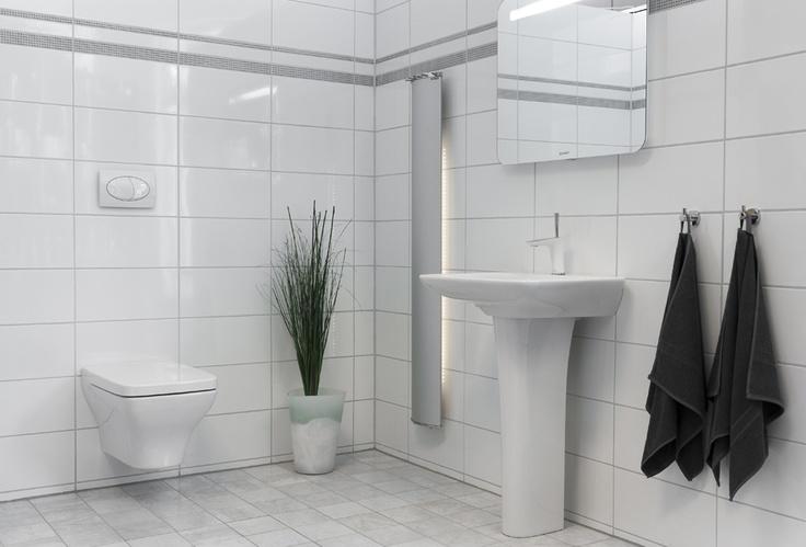 Vitt kakel på väggar, ljusgrått golvkakel    Vit - Vägg: 20x40