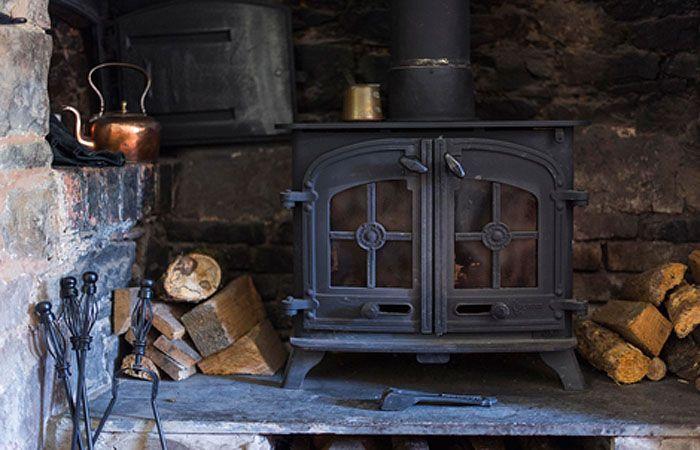 log burner in an inglenook fireplace