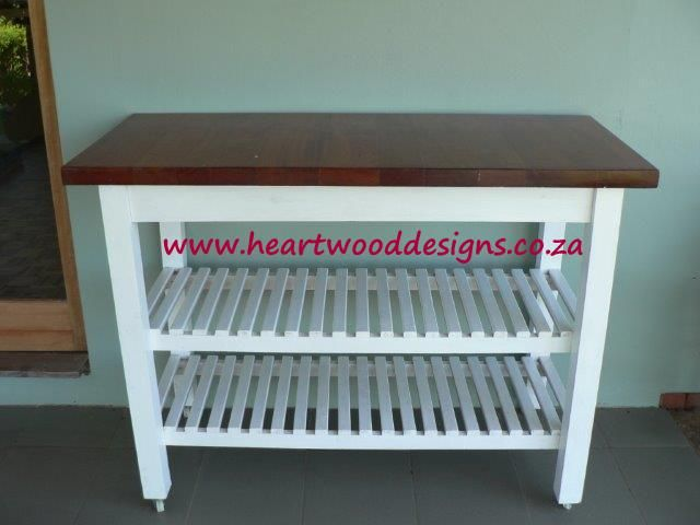 Our elegant serving trolley; can be used indoors or at a braai area.  The mahogany top adds sophistication to the piece, while the casters offer easy mobility.