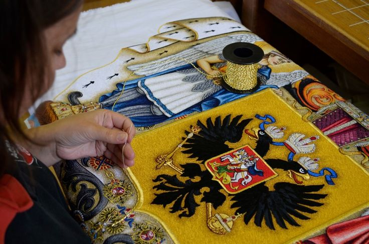 During a hand sewing a flag.