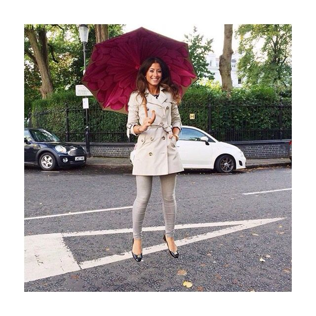 With the beautiful #Brellini line of umbrellas, Mimi carries the rainy day vibes throughout with a beautiful trench. All neutrals but with a surprise pop of hot pink. | @mimiikonn from Instagram.