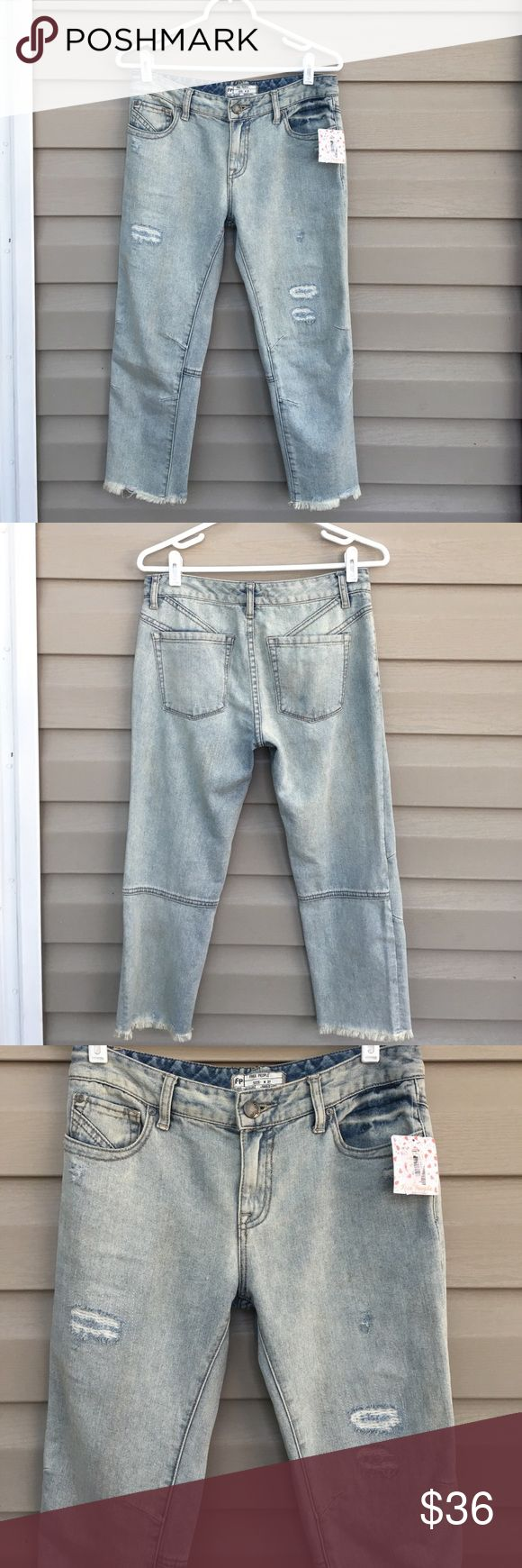 "Free People women's jeans NWT NWT women's jeans waist 27""length 22"",100% cotton, distressed , bleached with no stains or unintentional holes. Very soft Free People Jeans Ankle & Cropped"